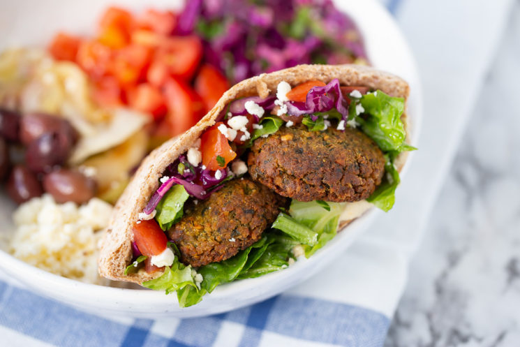 falafel served in a pita stuffed with veggies served in a bowl