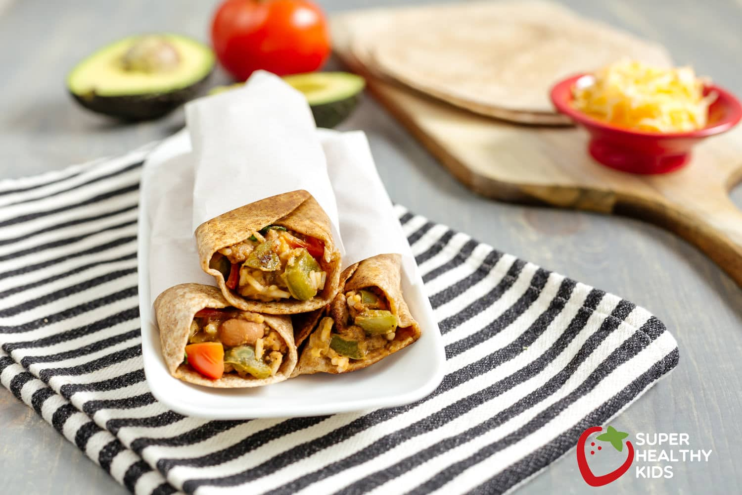 rice and veggie burritos wrapped in paper