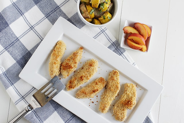 chicken tenders on a white serving plate