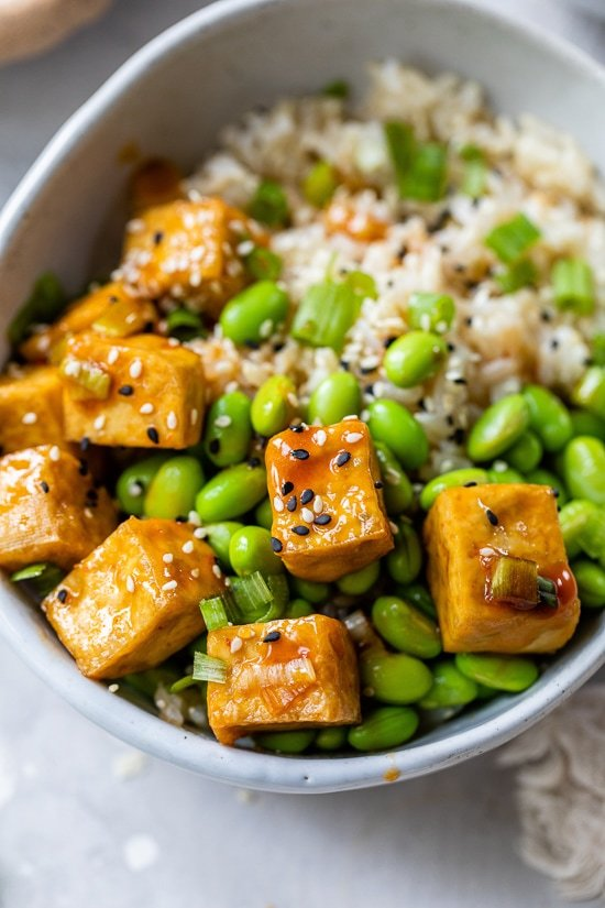 These Spicy Sriracha Tofu Rice Bowls make a flavorful protein-packed meatless meal that comes together quickly!