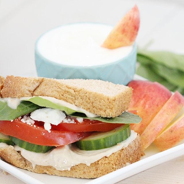 veggie sandwich served with apple slices