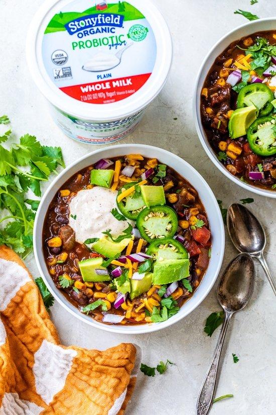 Black Bean Vegetarian Chili topped with yogurt, jalapenos, cheese and avocado.